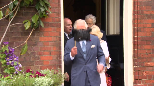 exterior views of prince charles and camilla the duchess of cornwall walking into the garden at the elephant family annual charity ball at clarence... - house call stock videos and b-roll footage