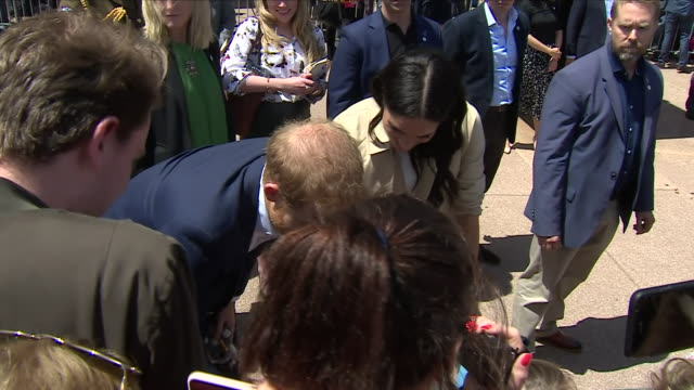 Exterior views of Prince Harry and Meghan The Duke and Duchess of Sussex on a walkabout in Sydney and receiving gifts from the crowd on October 16...