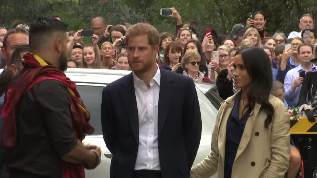 exterior views of prince harry and meghan the duke and duchess of sussex being shown a wall art mural on the side of fitzroy's charcoal lane an... - sussex stock videos and b-roll footage