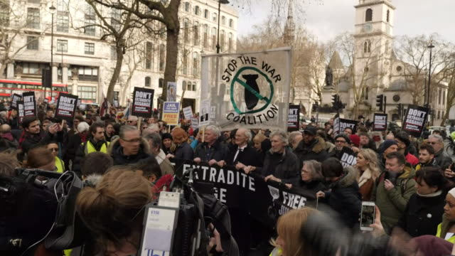 exterior views of protesters and supporters of julian assange, including his father john shipton and musician roger waters starting a march to... - shirt and tie stock videos & royalty-free footage