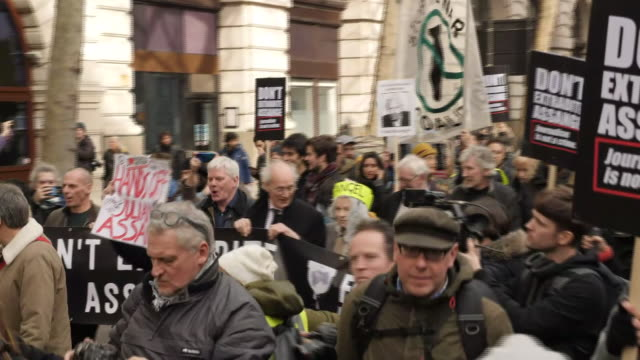 exterior views of protesters and supporters of julian assange, including his father and vivienne westwood on a march to protest his extradition on 22... - shirt and tie stock videos & royalty-free footage