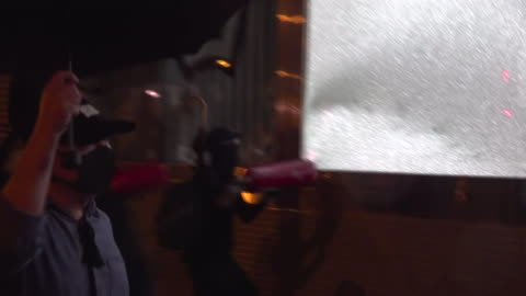 exterior views of protesters trying to break windows at a mtr subway station using iron bars and fire extinguishers on 6 october 2019 in hong kong,... - iron bars for windows stock videos & royalty-free footage