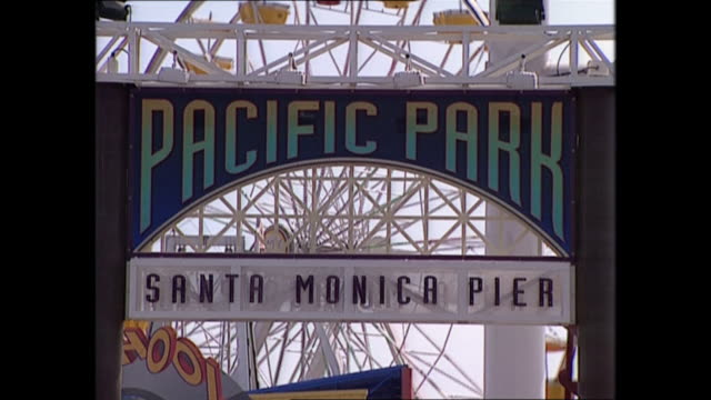 exterior views of santa monica including people the pier sign and the beach on 3 june 1997 in los angeles united states - santa monica pier sign stock videos & royalty-free footage
