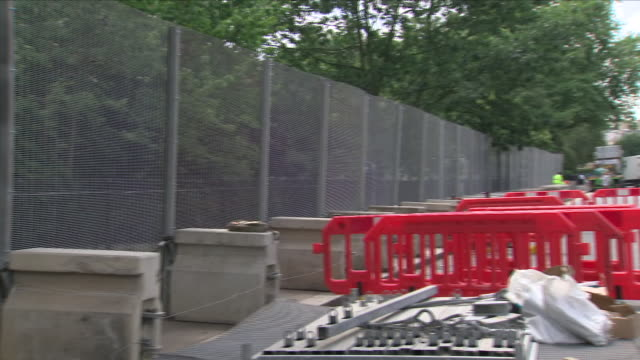 Exterior views of security measures being taken around Regent's Park in preparation for the visit of US President Trump including barriers being...
