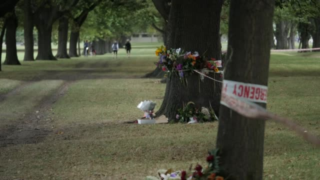 Exterior views of South Hagley park near the sight of the mass shooting at Al Noor mosque also including floral tributes placed on and around trees...