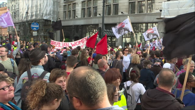 exterior views of the anti fascist counter protesters to the democratic football lads alliance march held in london including banners and flags on... - anti fascism stock videos & royalty-free footage