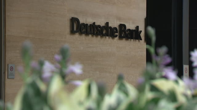 exterior views of the deutsche bank building in central london after announcing worldwide job cuts including bank sign and people walking out of the... - deutsche bank stock videos & royalty-free footage