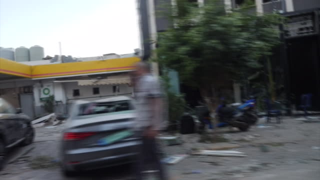 exterior views of the devastation on the streets, caused by the explosion, as seen from a travelling motorbike showing rubble and debris lying on the... - the cars stock videos & royalty-free footage