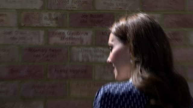 exterior views of the duchess of cambridge talking with staff as she is shown the new codebreakers memorial wall which shows her grandmothers name... - senior women stock videos & royalty-free footage