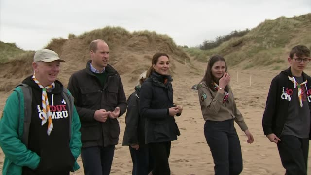 Exterior views of The Duke and Duchess of Cambridge arriving at Newborough Beach on Anglesey and meeting volunteers and school pupils as they prepare...