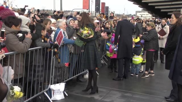 exterior views of the duke and duchess of cambridge as they greet fans and well wishers and are given gifts and flowers after opening the new v&a... - スコットランド ダンディー点の映像素材/bロール