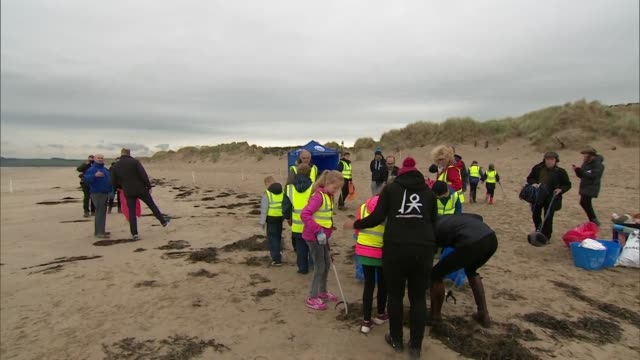 Exterior views of The Duke and Duchess of Cambridge helping volunteeers at a beach clean up at Newborough Beach on Anglesey on 8 May 2019 in Bangor...