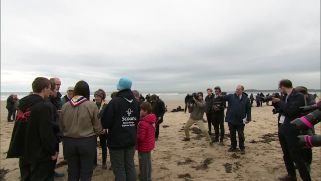 Exterior views of The Duke and Duchess of Cambridge talking with volunteers and school pupils as they prepare to help with a beach clean up at...