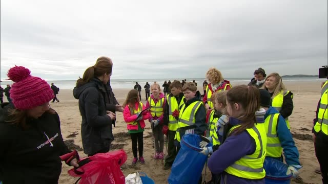 Exterior views of The Duke and Duchess of Cambridge talking with volunteeers as they prepare to help with a beach clean up at Newborough Beach on...