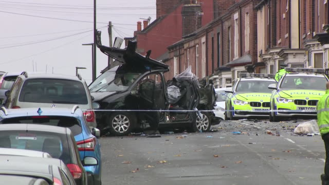 vídeos de stock e filmes b-roll de exterior views of the fatal car crash site in the darnall area of sheffield showing the wreckage of the vw golf behind police crime scene cordon tape... - golf