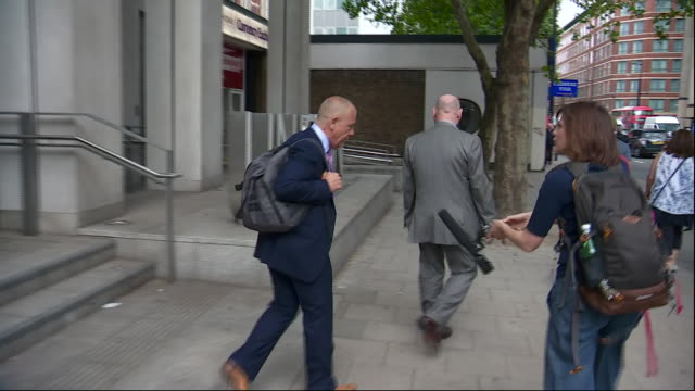 Exterior views of the GMB General Secretary Tim Roache leaving the UNISON building and being asked how the meeting went on 8 July 2019 in London...