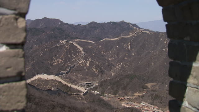 exterior views of the great wall near badaling including pans into the distance on 15 september 2010 in beijing china - great wall of china stock videos & royalty-free footage