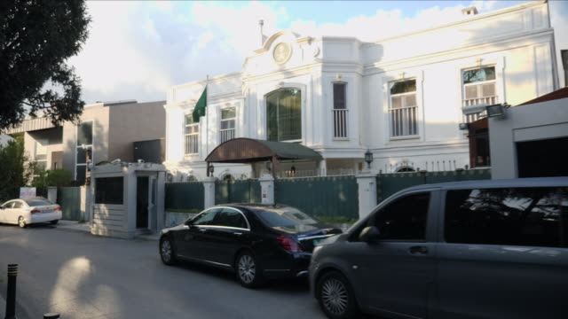 exterior views of the home of the saudi consul in istanbul including consul car saudi flag flying security cameras and security gate railings on... - istanbul stock videos & royalty-free footage