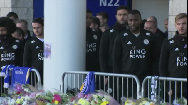 exterior views of the leicester city players coming out from the stadium and looking at the floral tributes at the king power stadium, including... - ジェームズ・マディソン点の映像素材/bロール