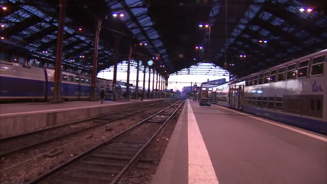 Exterior views of the main line station of Gare de Lyon showing SNCF trains at platforms and passengers walking down the platform on 16 January 2013...