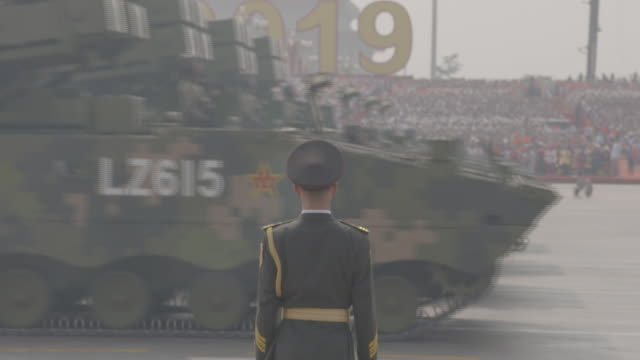 exterior views of the military parade taking place marking 70 years of communist rule, including military trucks and mini helicopters going past as a... - paraden stock-videos und b-roll-filmmaterial