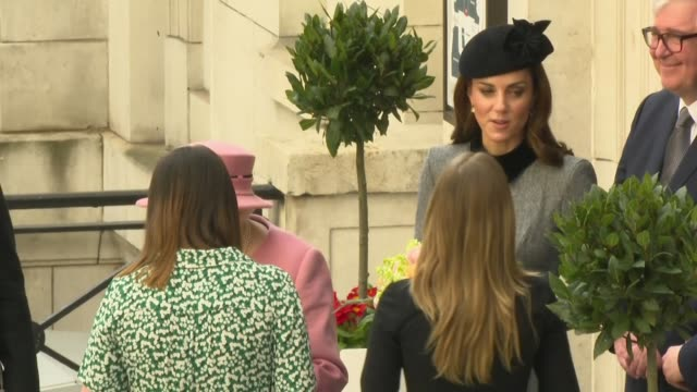 exterior views of the queen and the duchess of cambridge as they are handed flowers and drive off on departure from king's college 19 march 2019 in... - the queen stock videos and b-roll footage