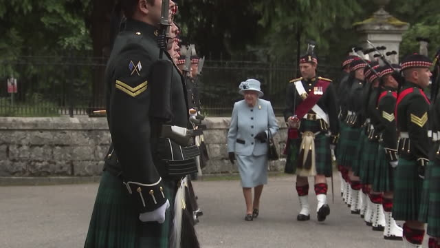 exterior views of the queen inspecting the royal regiment of scotland and then meeting the regiment's pony mascot at balmoral castle on 6 august 2019... - examining stock videos & royalty-free footage