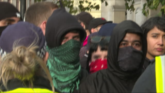 Exterior views of the riot police seen getting into formation at the Democratic Football Lads Alliance march in Trafalgar Square and keeping the...