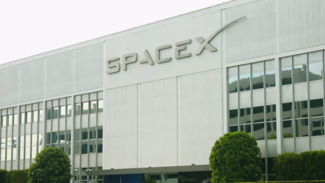 exterior views of the spacex headquarters in hawthorne california - space exploration stock videos & royalty-free footage