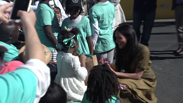 exterior views of the the duke and duchess of sussex greeting and shaking hands with the crowd in the historic bo- kaap neighbourhood on 24 september... - cape town stock videos & royalty-free footage