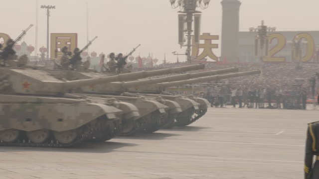 exterior views of tom cheshire reporting live from the military parade taking place marking 70 years of communist rule including military tanks going... - tank stock videos & royalty-free footage