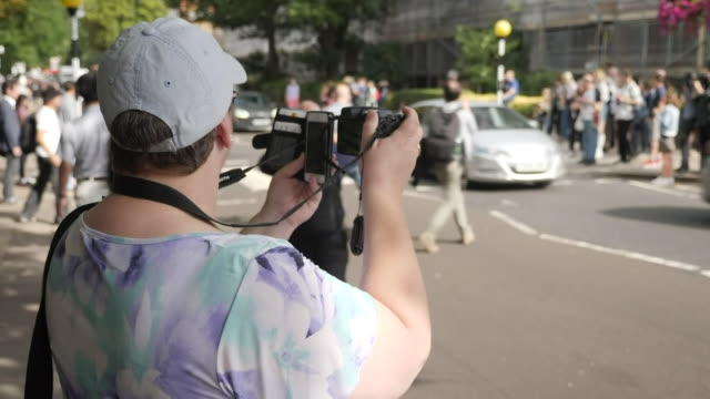 exterior views of tourists and fans recreating the iconic cover photo of the beatles album abbey road on the 50th anniversary of the photo as media... - zebra crossing stock videos & royalty-free footage