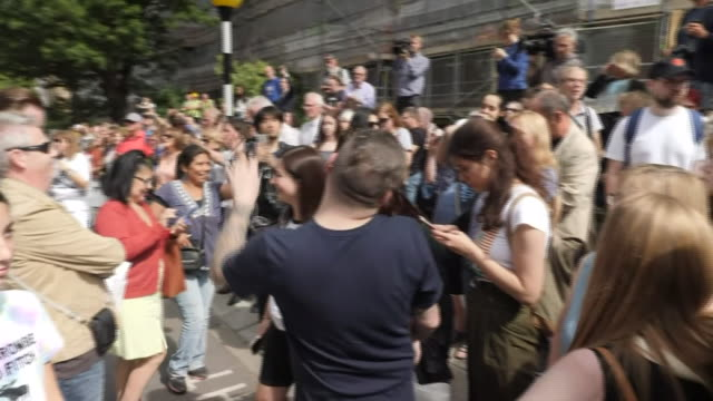 exterior views of tourists fans and media gathering on the zebra crossing to celebrate 50th anniversary of the abbey road cover photo as media and... - zebra crossing stock videos & royalty-free footage