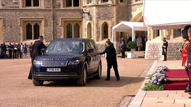 exterior views of us president trump and first lady melania trump arriving by car in windsor castle courtyard and are greeted by queen elizabeth ii... - windsor england stock videos and b-roll footage