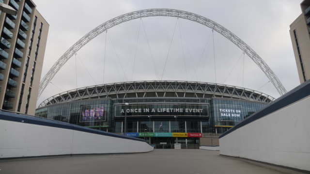 exterior views of wembley stadium after uefa announced that euro 2020 was being cancelled due to covid-19 outbreak, including view of the arch and... - arch stock videos & royalty-free footage