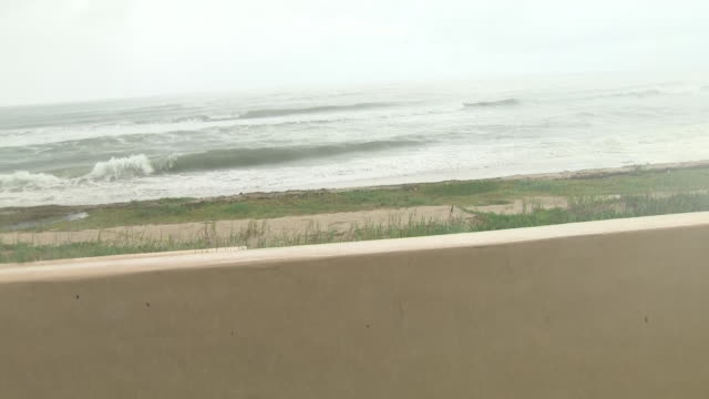 exterior views of west palm beach, where hurricane dorian is due to hit land in the next 24 hours, showing heavy rain and wind on 2 september 2019 in... - hinweisschild stock-videos und b-roll-filmmaterial