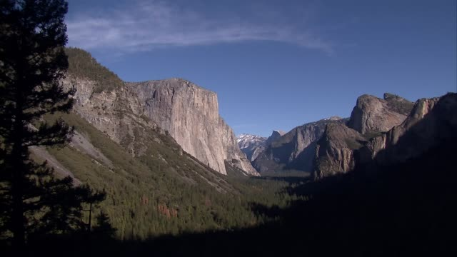 exterior views of yosemite national park looking down a valley towards el capitan rock formation including a waterfall on 15 january 2015 in yosemite... - californian sierra nevada stock videos & royalty-free footage