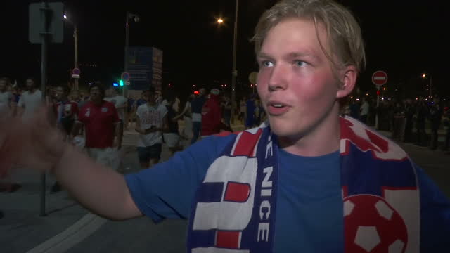 vídeos de stock, filmes e b-roll de exterior vox pop with an icelandic football fan reacting to the victory of iceland over england in euro 2016 saying that he thinks the icelandic... - euro 2016