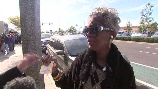 exterior voxpop w/ woman speaking on how she would spend her winnings - winnings stock videos and b-roll footage