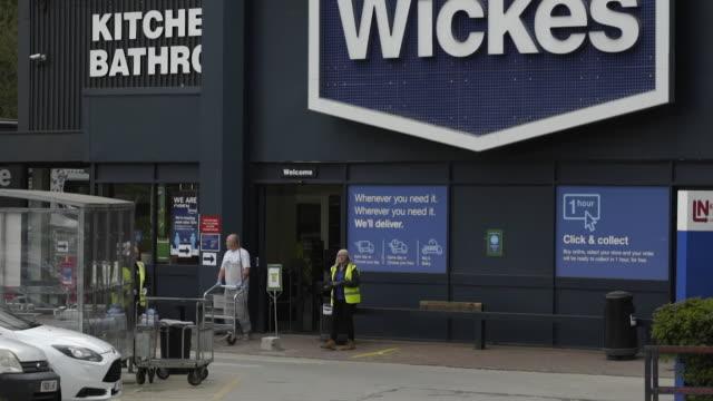 stockvideo's en b-roll-footage met exterior wickes diy store with people queueing outside after it opened after closing for coronavirus lockdown leeds - heropening