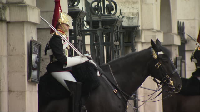 exterior wide, close up & focus pull shots of military horses with guards wearing their uniform bridle on whitehall, outside household calvery musuem... - bridle stock videos & royalty-free footage