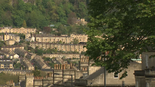 exterior wide location shots of bath city skyline with terraced houses built on hillsides church spire rising above rooflines of houses in bath... - somerset england stock videos & royalty-free footage