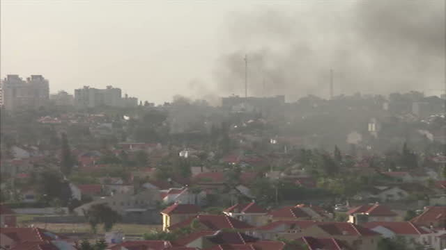 exterior wide locked off shot overlooking ashkelon in southern israel as a pall of smoke rises from a hamas rocket strike gaza conflict intensifies... - ashkelon stock videos and b-roll footage
