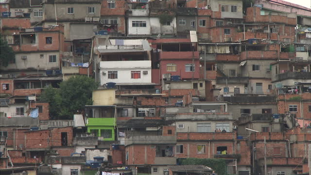 exterior wide shot flavela slum area in rio rio de janeiro stockshots on june 24 2013 in rio de janeiro brazil - wide stock videos & royalty-free footage