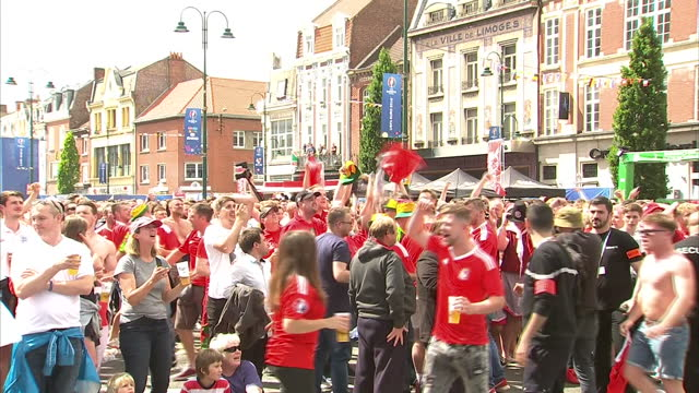 Exterior wide shot of a crowd of England football fans celebrating as England scores during the Euro 2016 match between England Vs Wales on June 16...