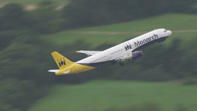 Exterior wide shot of a Monarch plane taking off from the runway at Gatwick Airport on September 26 2016 in London England