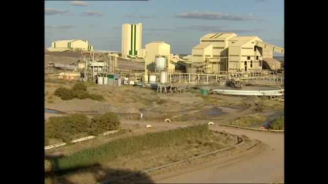 exterior wide shot of an open cast diamond mine in botswana on june 07, 2001 in unspecified, botswana. - ボツワナ点の映像素材/bロール