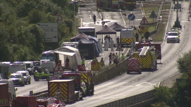 exterior wide shot of emergency services at scene of shoreham airshow plane crash on the a27 road on august 22 2015 in shorehambysea england - ショーハム・バイ・シー点の映像素材/bロール