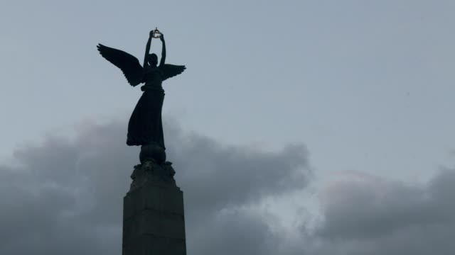 exterior wide shot of the angel of peace statue with clouds overhead in toronto ontario canada on june 24 2017 - statue stock videos & royalty-free footage