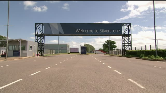 exterior wide shot of the silverstone circuit car entrance in northamptonshire, england. the shot features a huge sign with the words 'welcome to... - silverstone stock videos & royalty-free footage